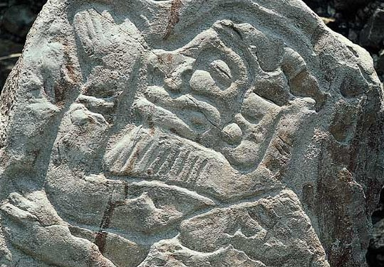 Bearded men carved in stone